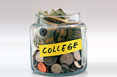 A glass jar full of money labelled college