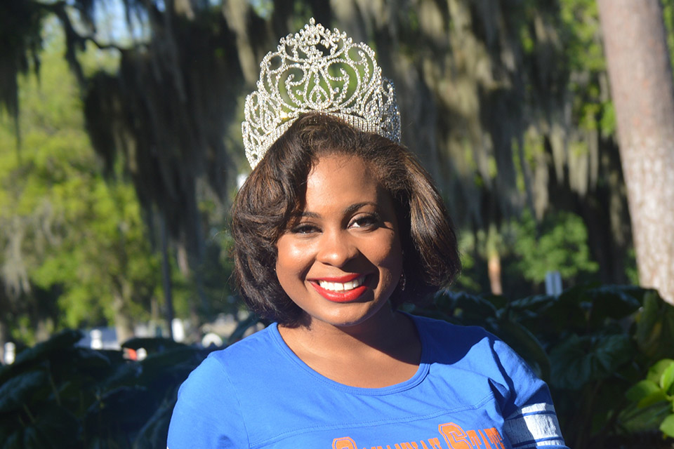 Miss SSU Morgan Wilson posing outside with crown