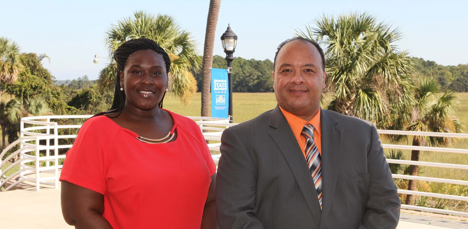 Tameka McDaniel and Gary Guillory posing for the Chancellor's Service Excellence Award.