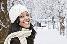 Smiling young women posing in winter scene
